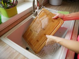 You've Been Cleaning Your Wooden Cutting Board Wrong Your Entire Life