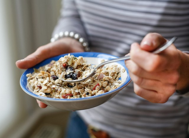 woman eating a bowl of oatmeal