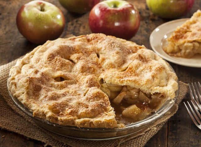 apple pie with slice and fresh apples