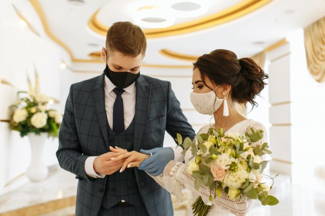 Masked bride and groom during a wedding ceremony