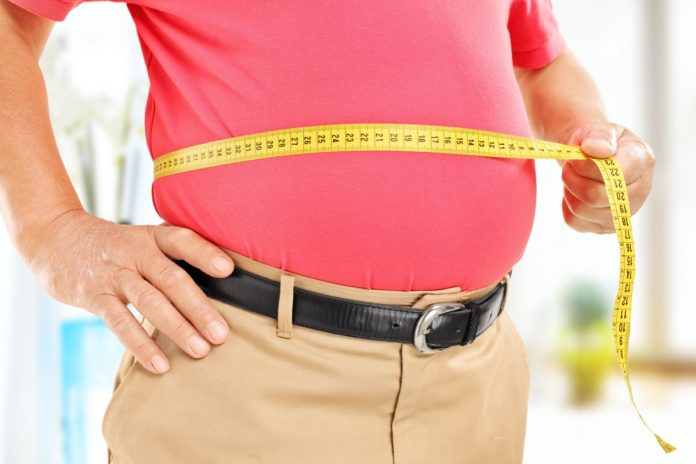 Losing Belly Fat Is the #1 Resolution for This Many Men, Survey Finds