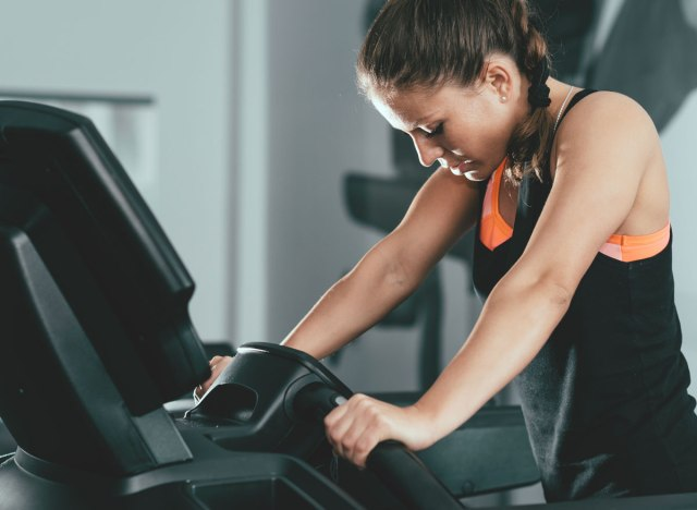 Tired woman at gym struggling to finish treadmill workout