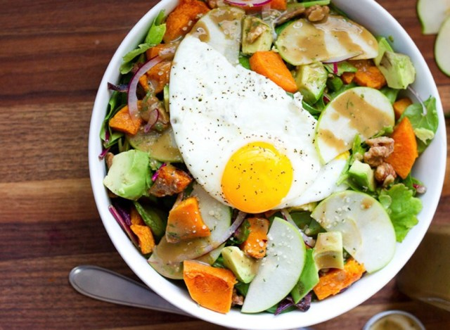 Salad with an egg in a bowl