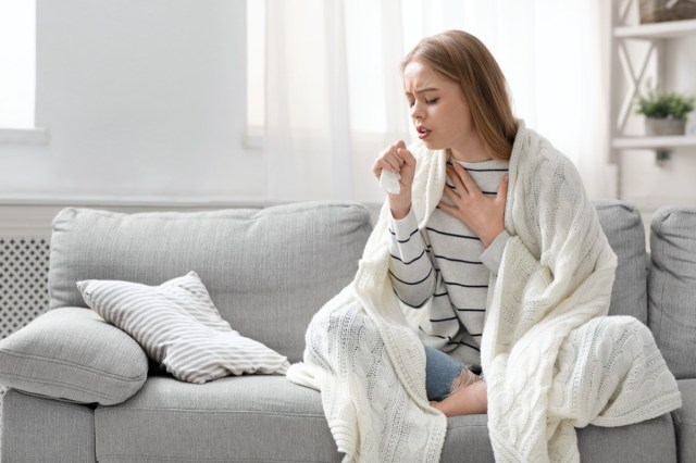 Woman coughing hardly at home