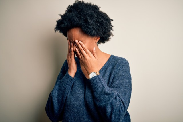 African American afro woman with curly hair wearing casual sweater rubbing eyes for fatigue and headache, sleepy and tired expression