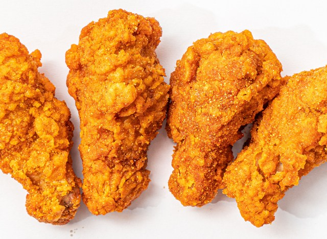 four fried chicken wings on a white background