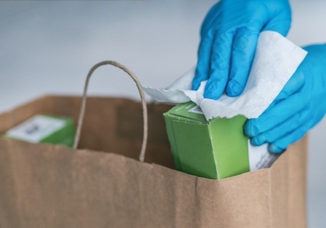 wiping down grocery packages
