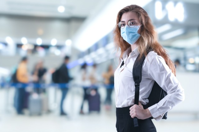 Virus mask woman travel wearing face protection in prevention for coronavirus at airport.