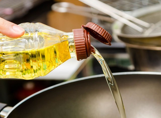 Pouring canola oil into pan
