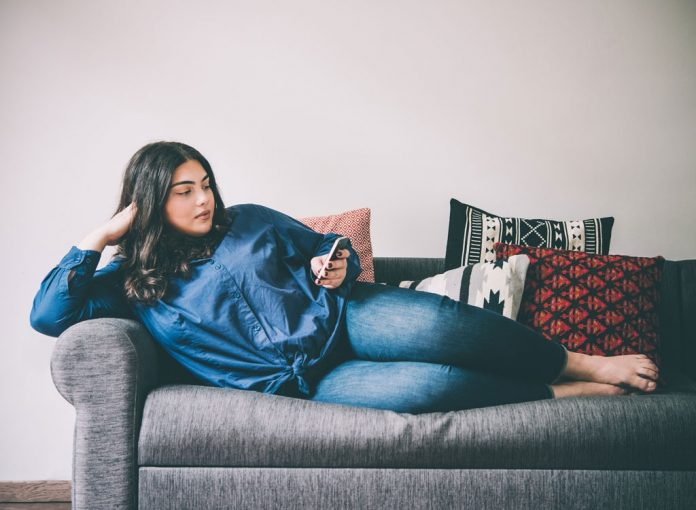 Sitting on the Couch for This Long Is Terrible for Your Body, Says Mayo Clinic