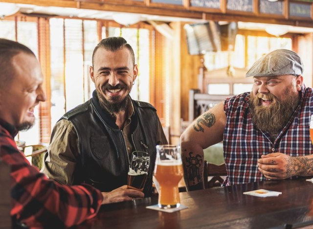 Men and guys out drinking beer at a bar