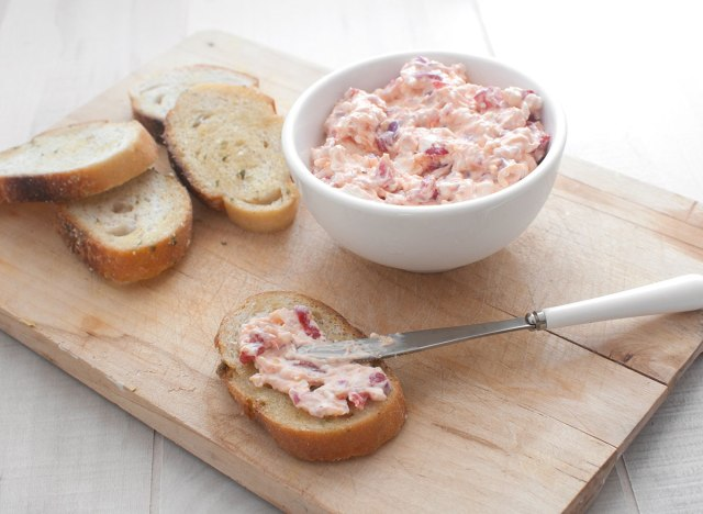 pimento cheese bread spread with knife