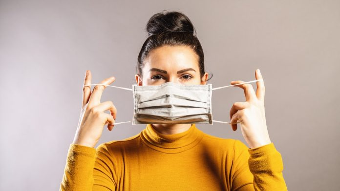 If You're Wearing Your Mask This Way, CDC Says Stop Immediately