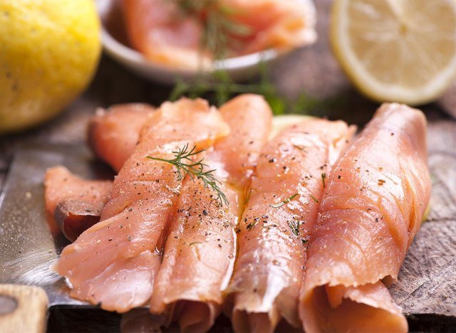 slices of smoked salmon on wooden board
