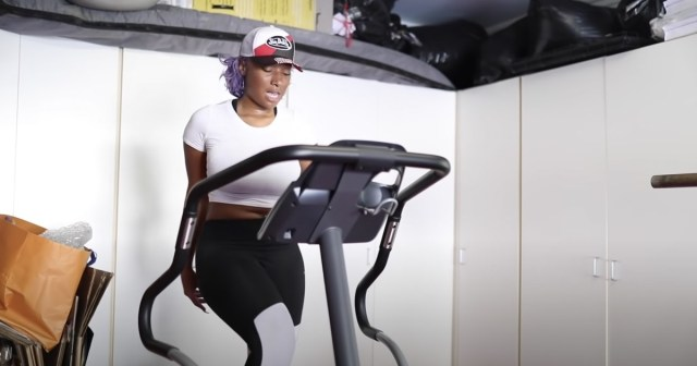 megan thee stallion working out on stair stepper
