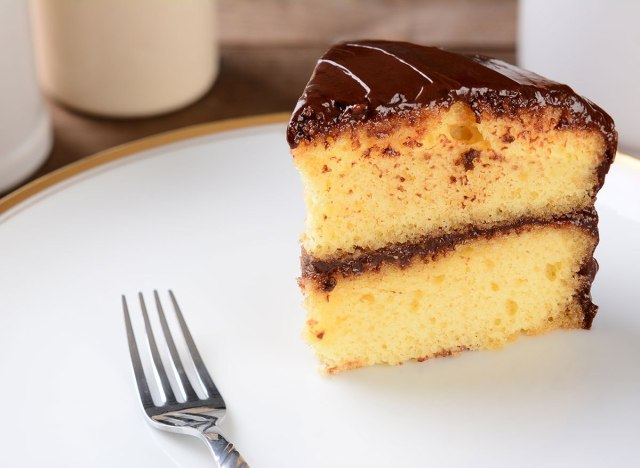chocolate yellow cake slice with fork on plate