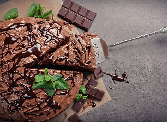 whole chocolate cake garnished with mint leaves