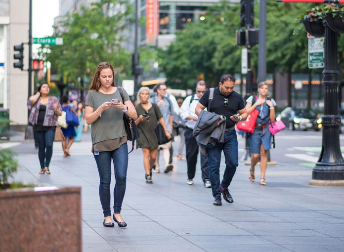 One Thing You Should Never Do While Walking, Says New Research
