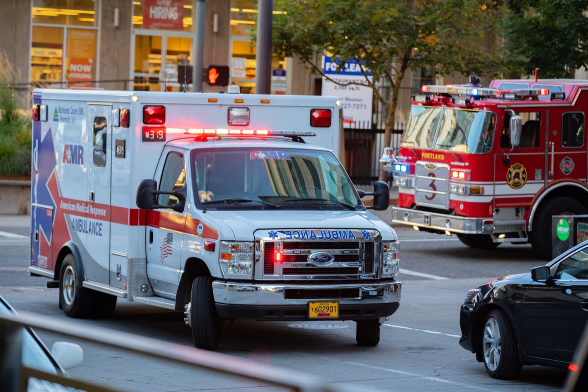 Ambulance and firefighter trucks block the street in downtown