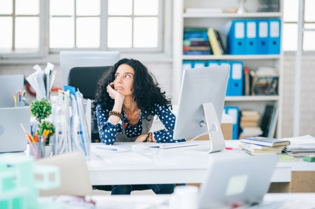Woman distracted in her office.
