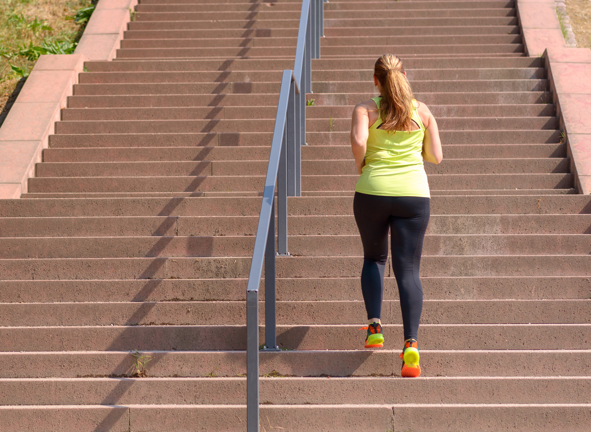Woman walking up stairs to exercise