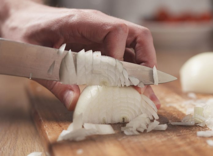 The One Hack For Cutting Onions, According to an Expert