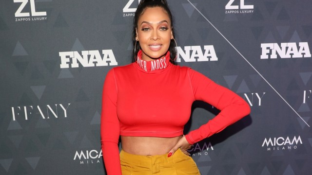 la la anthony in red crop top and yellow pants