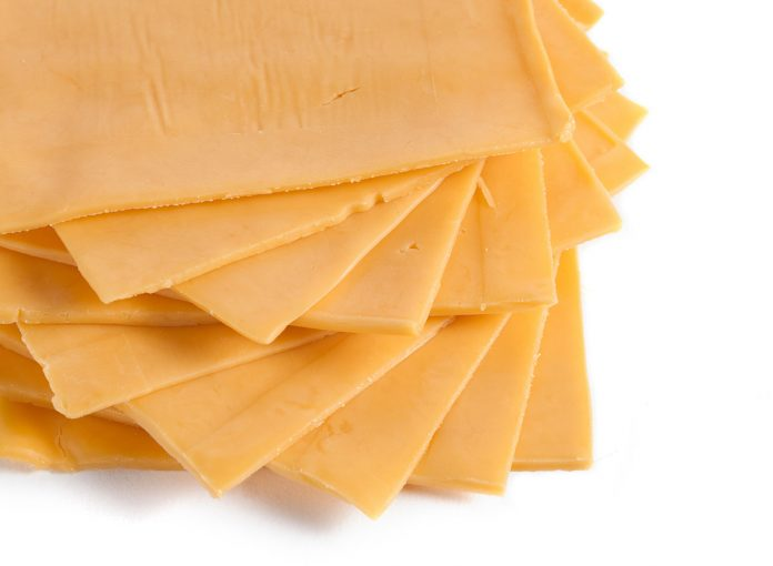 One Major Side Effect of Eating American Cheese, Say Experts
