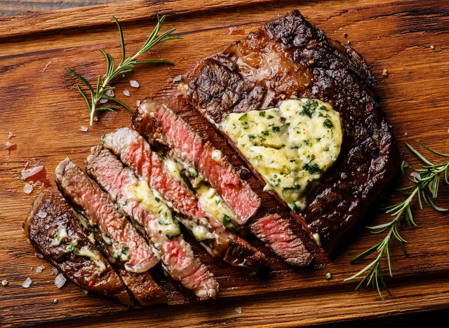 sliced steak topped with compound butter