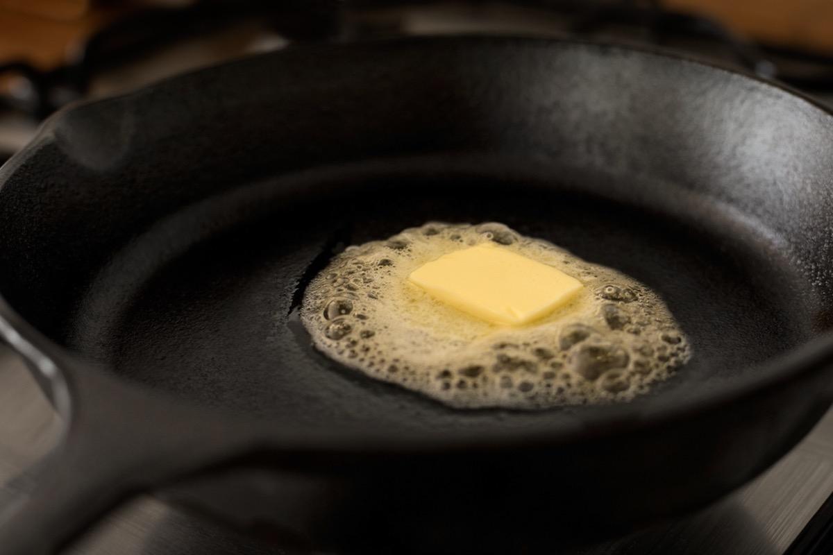 pat of butter melting in pan
