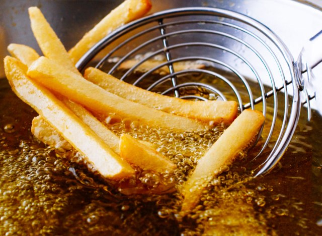 Deep fry french fries in oil