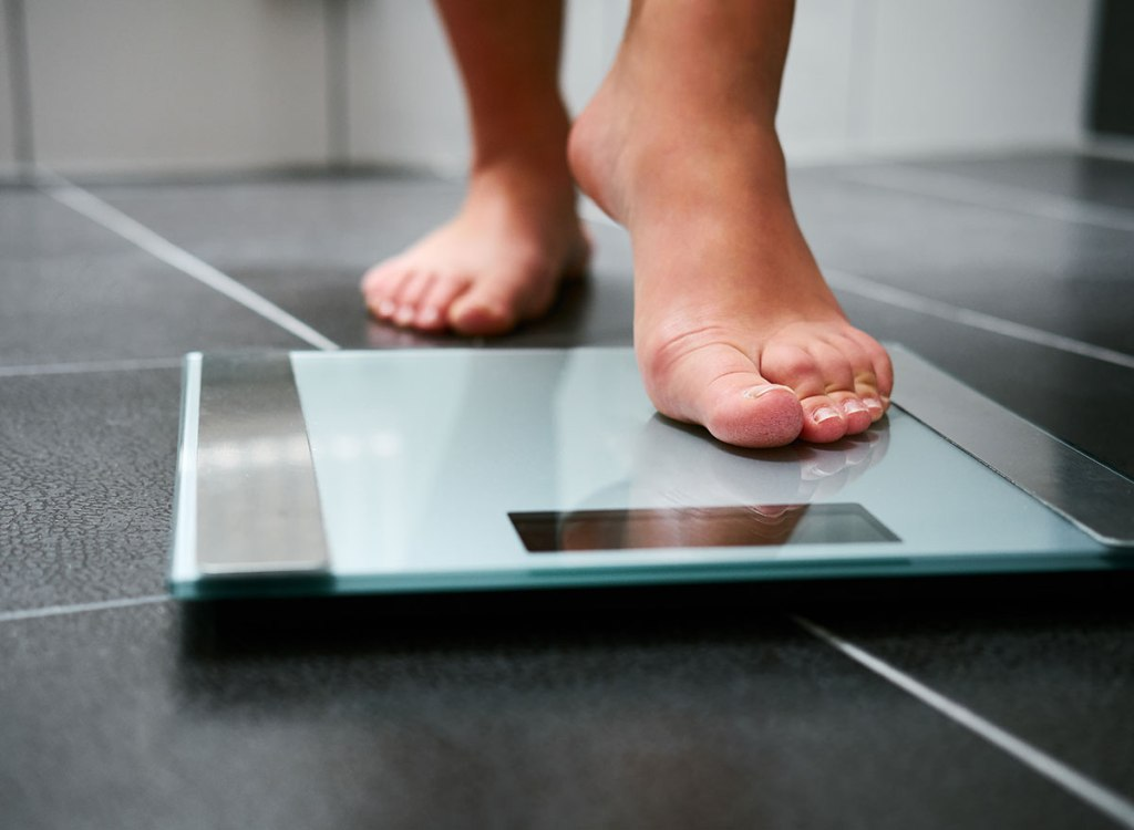 stepping on scale weight loss