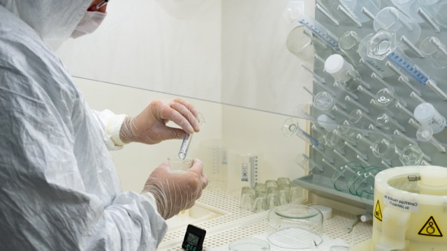 Scientist in laboratory studying and analyzing scientific sample of Coronavirus monoclonal antibodies to produce drug treatment for COVID-19.