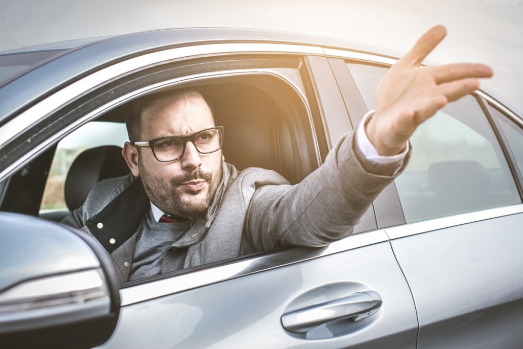 male driver shouts and gestures threateningly