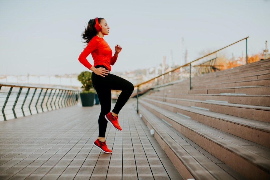 View at young woman exercising outside