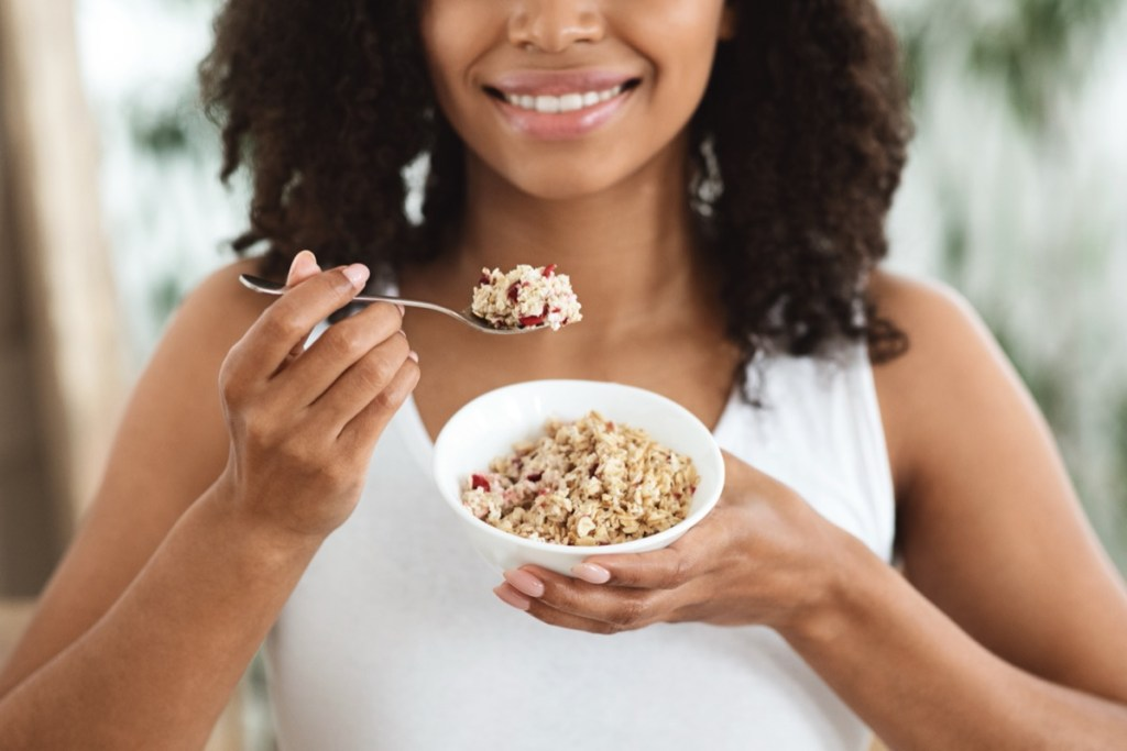 young woman eating oatmeal
