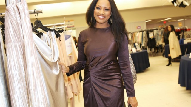 garcelle beauvais in ruched brown silk dress