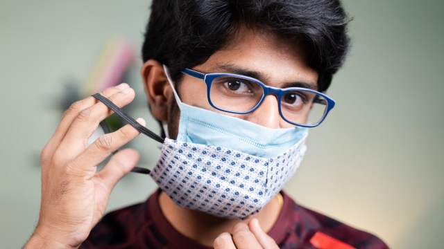 Young man wearing two face masks.