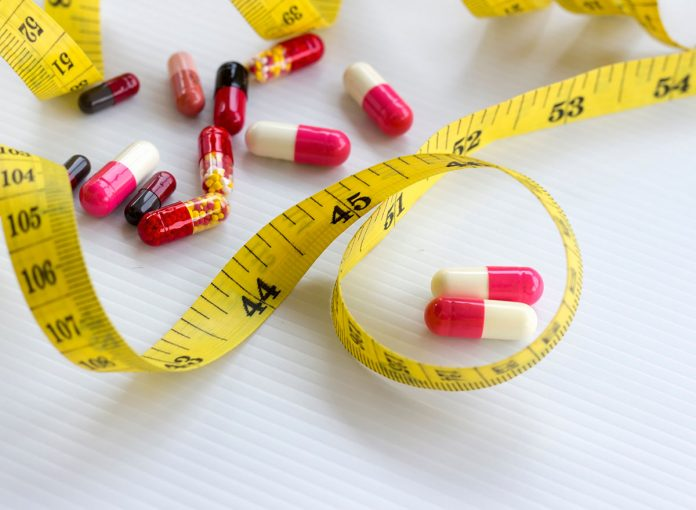 One Major Side Effect of Taking Fat-Burning Supplements, Says Dietitian