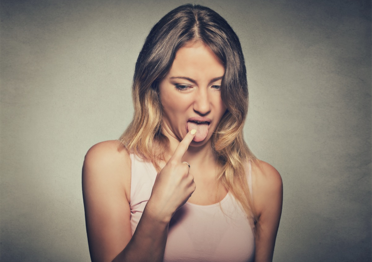 woman, annoyed, frustrated fed up sticking her finger in her throat
